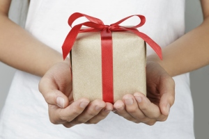 young female hands holding gift